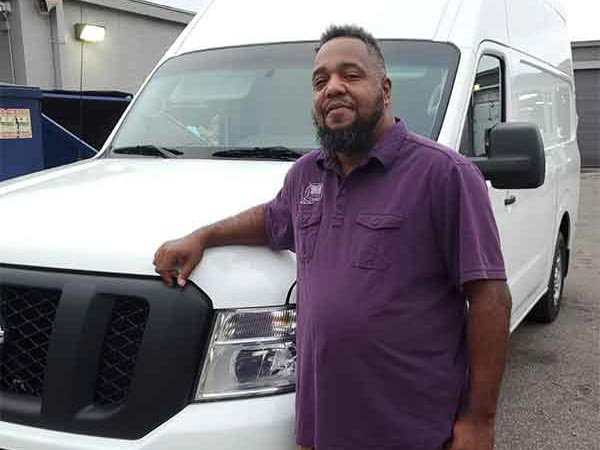 Mojo courier prepares for auto parts delivery in Orlando